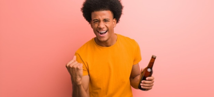 Thumb 700 320 young african american man holding beer surprised shocked 1187 17598